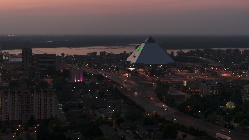 5.7K stock footage aerial video of orbiting the Memphis Pyramid at twilight, Downtown Memphis, Tennessee Aerial Stock Footage | DX0002_187_013