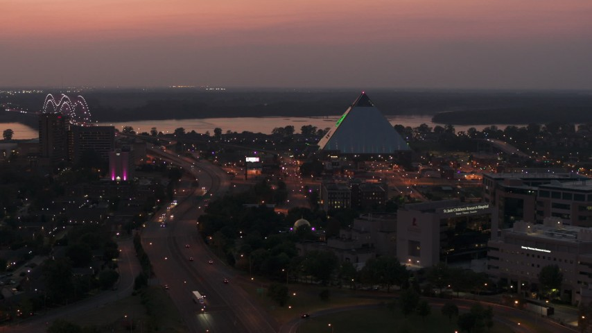 5.7K stock footage aerial video an orbit of the Memphis Pyramid at twilight, Downtown Memphis, Tennessee Aerial Stock Footage | DX0002_187_014