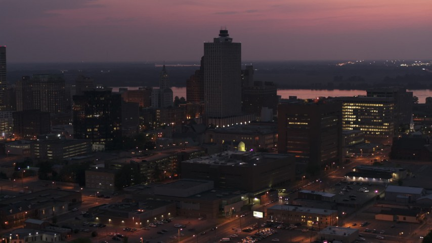 5.7K stock footage aerial video of the 100 North Main office tower at twilight, Downtown Memphis, Tennessee Aerial Stock Footage | DX0002_187_017