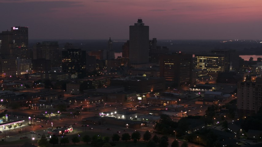 5.7K stock footage aerial video approach and orbit the 100 North Main office tower at twilight, Downtown Memphis, Tennessee Aerial Stock Footage | DX0002_187_019