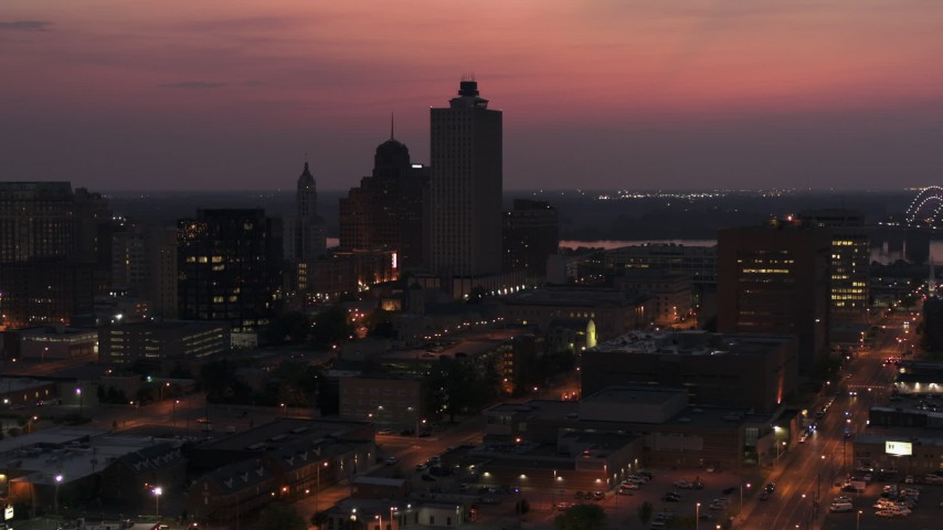 5.7K stock footage aerial video fly toward and away from the 100 North Main office tower at twilight, Downtown Memphis, Tennessee Aerial Stock Footage | DX0002_187_020
