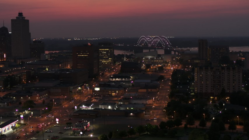 5.7K stock footage aerial video a view of lights on the Hernando de Soto Bridge at twilight, Downtown Memphis, Tennessee Aerial Stock Footage | DX0002_187_021