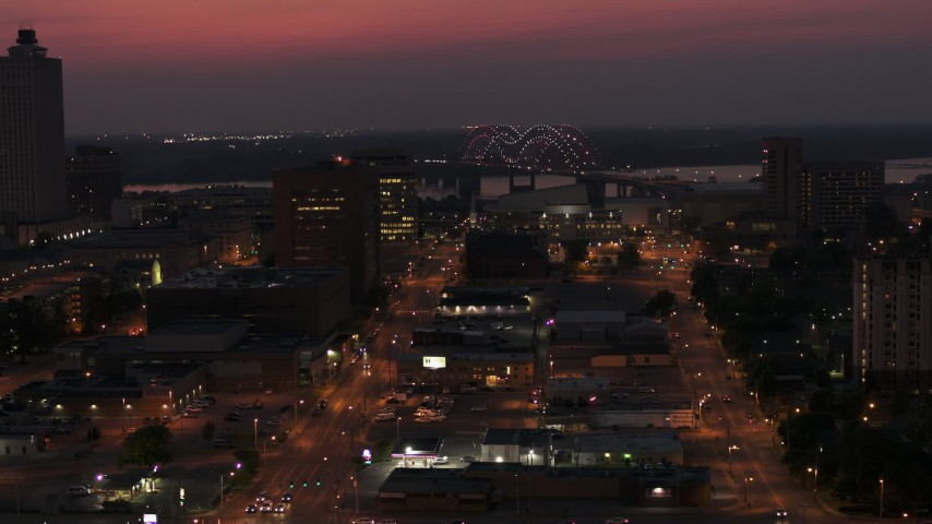 5.7K stock footage aerial video of a light show on the Hernando de Soto Bridge at twilight, Downtown Memphis, Tennessee Aerial Stock Footage | DX0002_187_022