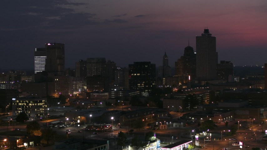 5.7K stock footage aerial video ascend past downtown skyline at twilight, Downtown Memphis, Tennessee during descent Aerial Stock Footage | DX0002_187_024