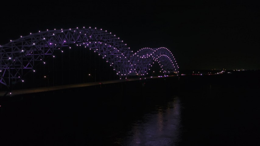 5.7K stock footage aerial video of a stationary view of the bridge with purple lights at night, Memphis, Tennessee Aerial Stock Footage | DX0002_187_029