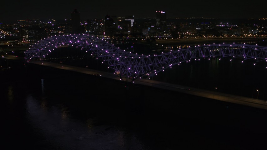 5.7K stock footage aerial video orbit the bridge with purple lights at night, reveal Downtown Memphis skyline, Tennessee Aerial Stock Footage | DX0002_187_032