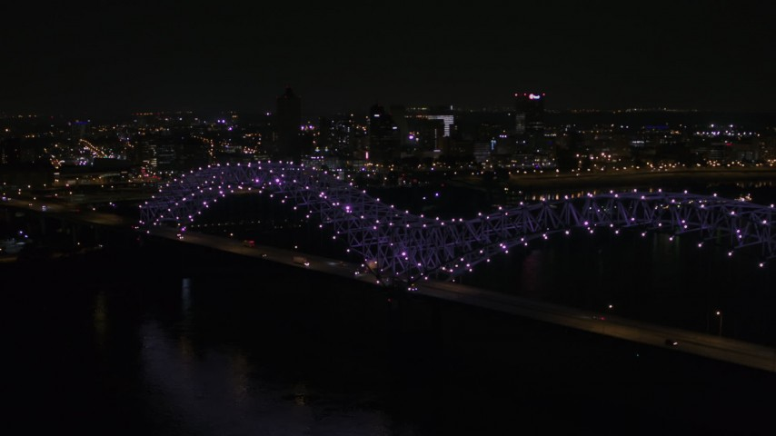 5.7K stock footage aerial video a stationary view of the bridge with purple lights and the Downtown Memphis skyline, Tennessee Aerial Stock Footage | DX0002_187_033