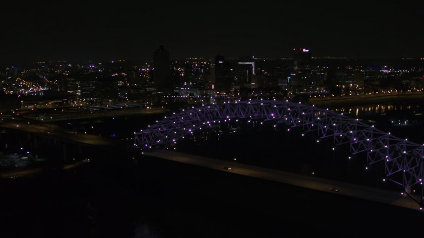 5.7K stock footage aerial video of flying by the bridge with purple lights and the Downtown Memphis skyline, Tennessee Aerial Stock Footage | DX0002_187_034