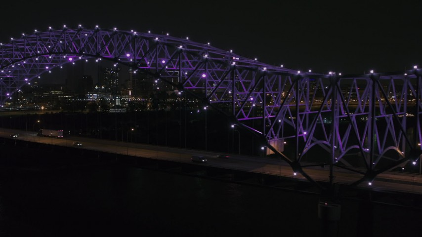 5.7K stock footage aerial video of passing the bridge with purple lights and a view of the skyline at night, Downtown Memphis, Tennessee Aerial Stock Footage | DX0002_187_036