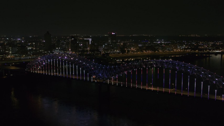 5.7K stock footage aerial video of the skyline seen from the bridge with colorful lights at night, Downtown Memphis, Tennessee Aerial Stock Footage | DX0002_187_039