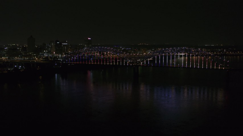 5.7K stock footage aerial video stationary view of the skyline and the bridge with colorful lights at night, Downtown Memphis, Tennessee Aerial Stock Footage | DX0002_187_044