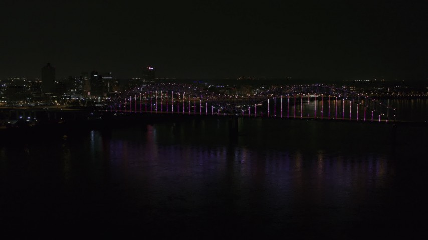 5.7K stock footage aerial video static view of the skyline and the bridge with colorful lights at night, Downtown Memphis, Tennessee Aerial Stock Footage | DX0002_187_045
