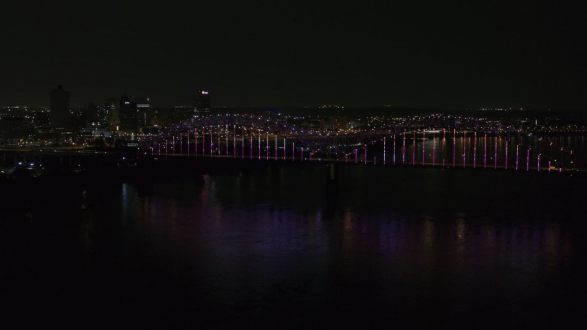 5.7K stock footage aerial video a slow approach to the bridge with colorful lights and skyline at night, Downtown Memphis, Tennessee Aerial Stock Footage | DX0002_187_046