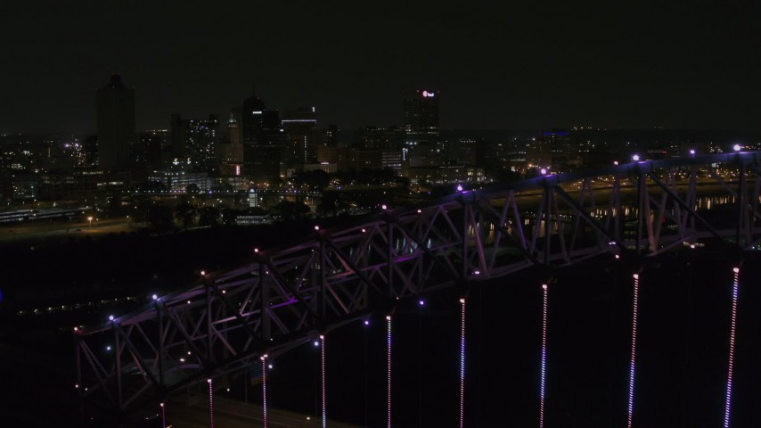 5.7K stock footage aerial video of flying by the skyline at night and reveal the bridge, Downtown Memphis, Tennessee Aerial Stock Footage | DX0002_187_049
