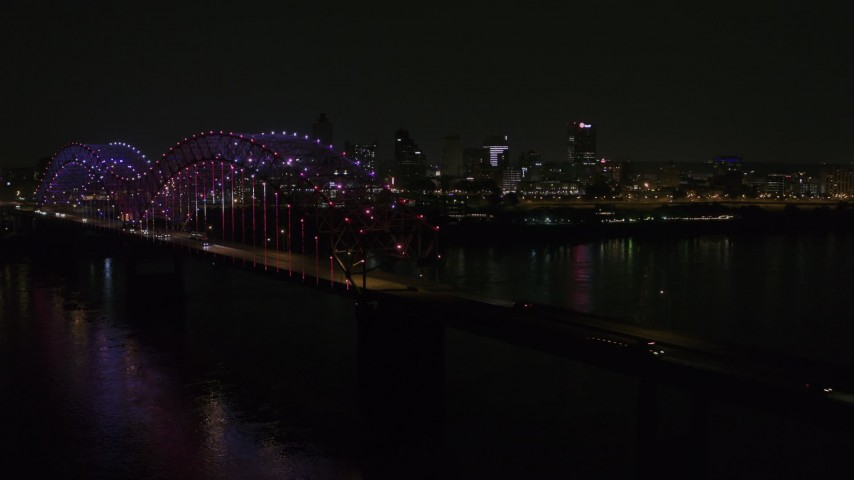 5.7K stock footage aerial video of lights on the bridge at night near Downtown Memphis, Tennessee Aerial Stock Footage | DX0002_187_051