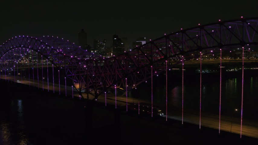 5.7K stock footage aerial video of flying by colorful lights on the bridge at night near Downtown Memphis, Tennessee Aerial Stock Footage | DX0002_187_052