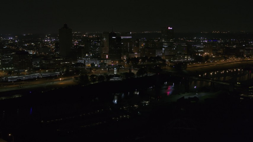 5.7K stock footage aerial video of passing lights on the bridge at night to reveal Downtown Memphis, Tennessee Aerial Stock Footage | DX0002_187_053