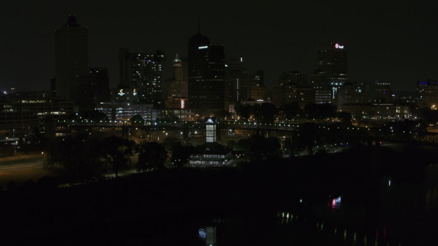 5.7K stock footage aerial video ascend toward skyline and welcome center at night, Downtown Memphis, Tennessee Aerial Stock Footage | DX0002_187_055