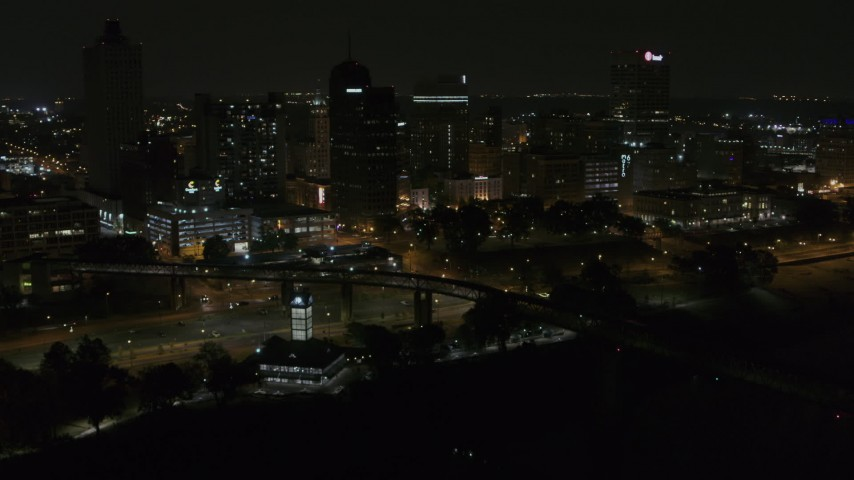 5.7K stock footage aerial video approach and orbit the city's downtown skyline at night, Downtown Memphis, Tennessee Aerial Stock Footage | DX0002_187_060