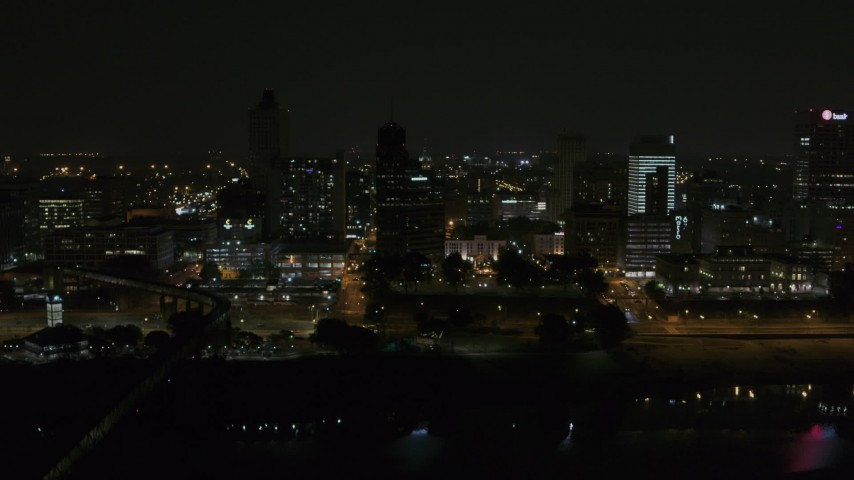 5.7K stock footage aerial video orbit around the city's downtown skyline at night, Downtown Memphis, Tennessee Aerial Stock Footage | DX0002_187_061