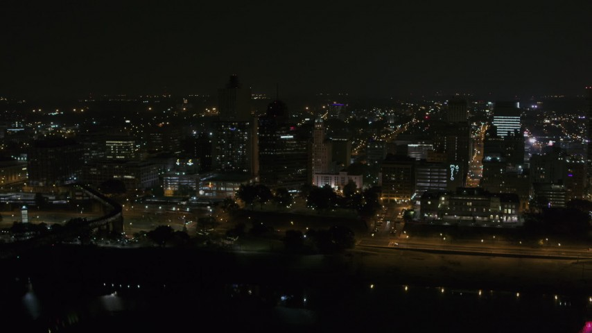 5.7K stock footage aerial video orbit office tower and downtown skyline at night, Downtown Memphis, Tennessee Aerial Stock Footage | DX0002_187_062