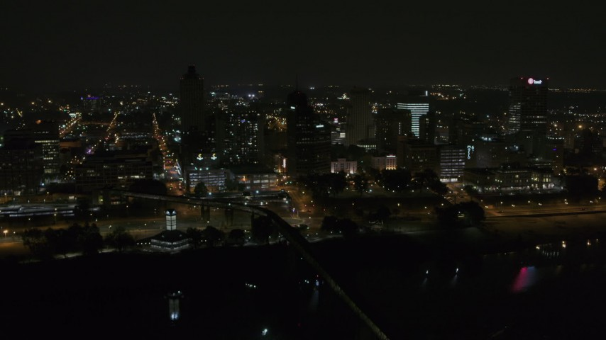 5.7K stock footage aerial video approaching apartment and office high-rises at night, Downtown Memphis, Tennessee Aerial Stock Footage | DX0002_187_064