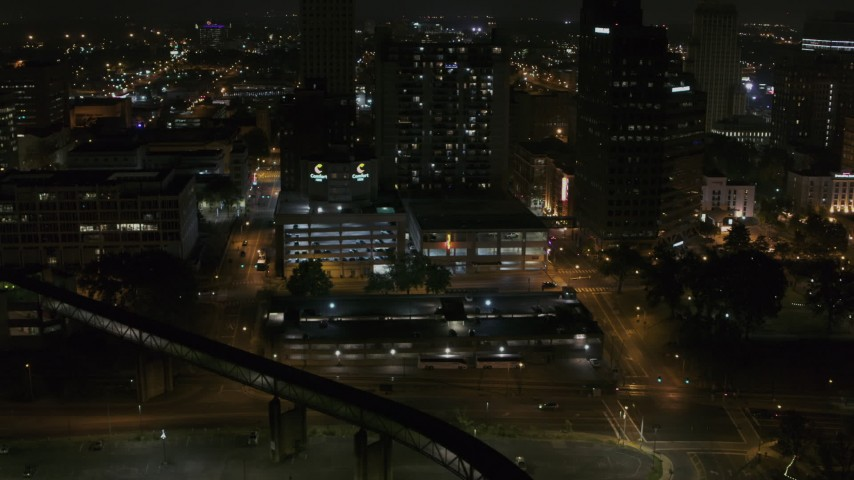 5.7K stock footage aerial video approaching apartment high-rise and parking garage at night, Downtown Memphis, Tennessee Aerial Stock Footage | DX0002_187_065