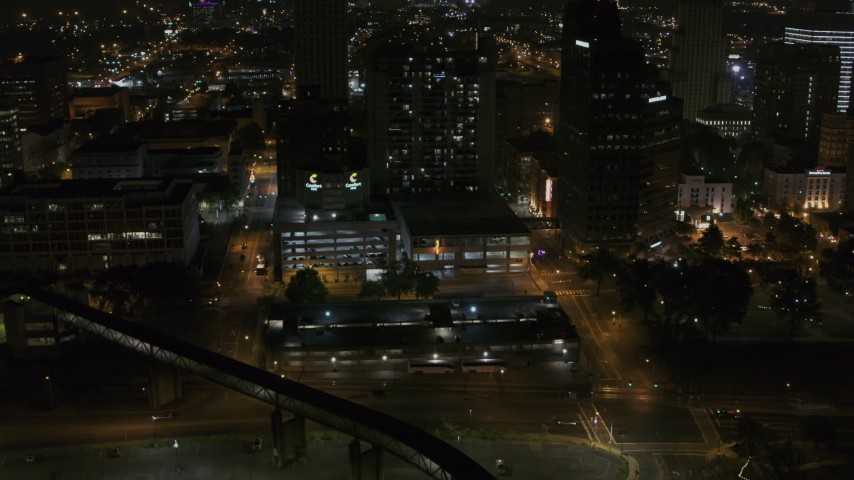 5.7K stock footage aerial video reverse view of apartment high-rise and parking garage at night, Downtown Memphis, Tennessee Aerial Stock Footage | DX0002_187_066