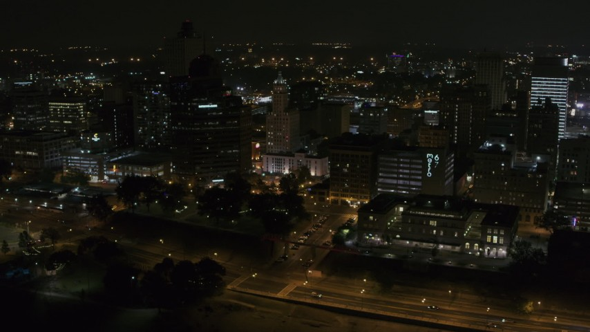 5.7K stock footage aerial video orbiting office high-rise and downtown buildings at night, Downtown Memphis, Tennessee Aerial Stock Footage | DX0002_187_067