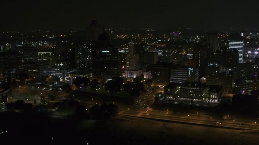 5.7K stock footage aerial video orbiting downtown buildings by office high-rise at nighttime, Downtown Memphis, Tennessee Aerial Stock Footage | DX0002_187_068