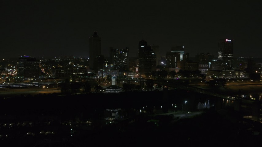 5.7K stock footage aerial video of the city's downtown skyline at nighttime while descending, Downtown Memphis, Tennessee Aerial Stock Footage | DX0002_187_070