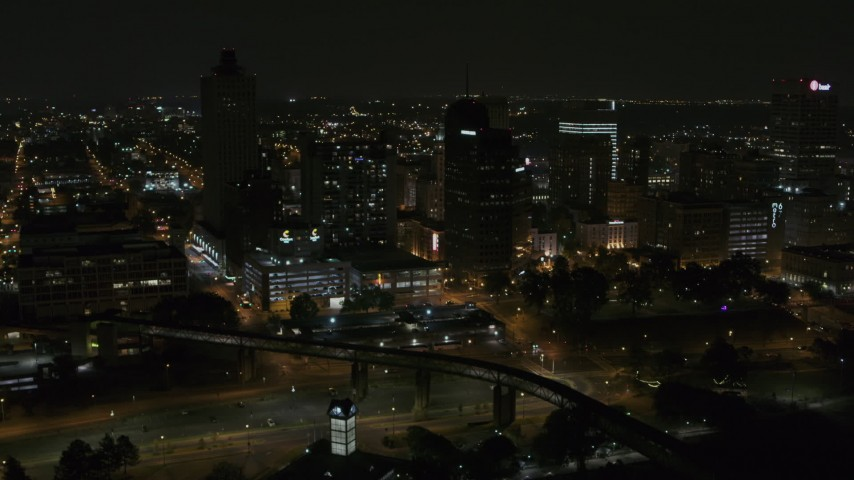 5.7K stock footage aerial video of ascending toward the city's downtown skyline at nighttime, Downtown Memphis, Tennessee Aerial Stock Footage | DX0002_187_071