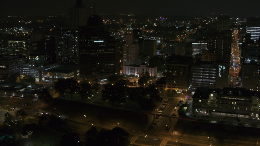 5.7K stock footage aerial video of Raymond James Tower and nearby buildings at nighttime, Downtown Memphis, Tennessee Aerial Stock Footage | DX0002_187_075