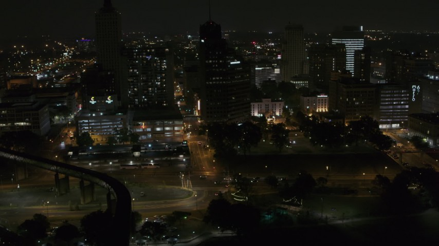 5.7K stock footage aerial video fly away from Raymond James Tower and nearby buildings at nighttime, Downtown Memphis, Tennessee Aerial Stock Footage | DX0002_187_076