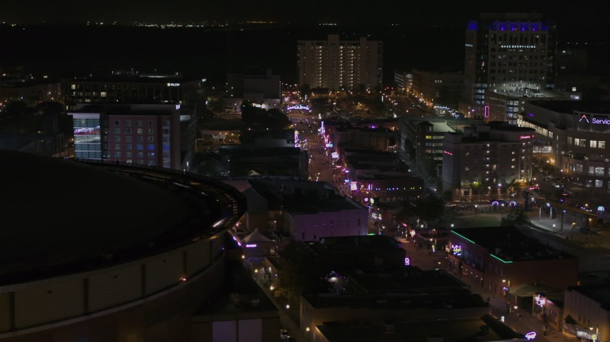 5.7K stock footage aerial video flyby arena to reveal Beale Street at nighttime, Downtown Memphis, Tennessee Aerial Stock Footage | DX0002_188_002