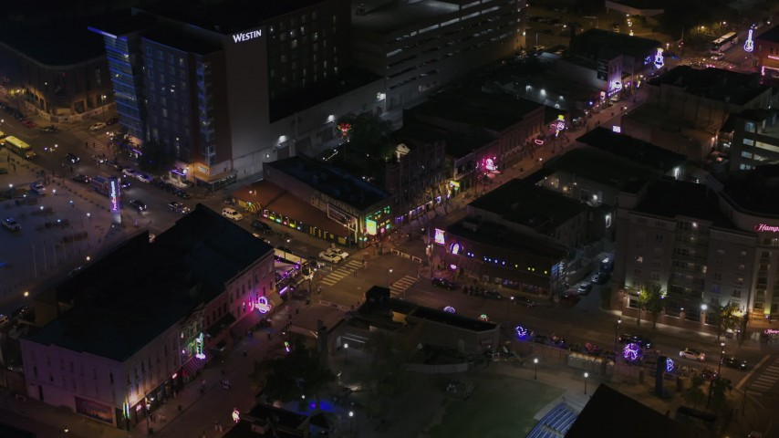 5.7K stock footage aerial video approach and fly away from Beale Street intersection at nighttime, Downtown Memphis, Tennessee Aerial Stock Footage | DX0002_188_003