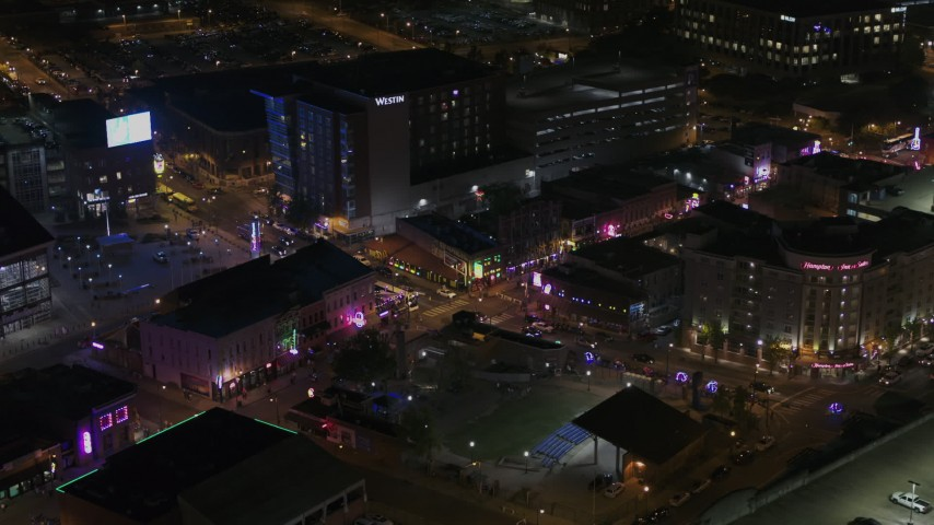 5.7K stock footage aerial video of orbiting the Beale Street intersection at nighttime, Downtown Memphis, Tennessee Aerial Stock Footage | DX0002_188_004