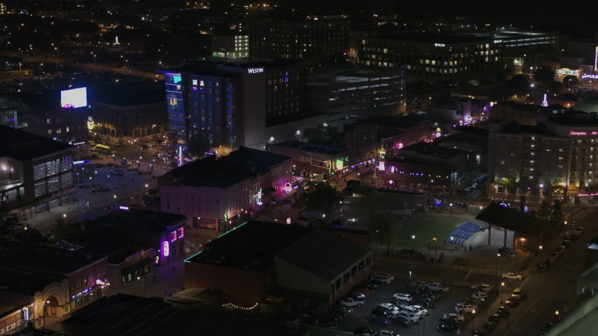 5.7K stock footage aerial video of flying by bright lights and signs on Beale Street at nighttime, Downtown Memphis, Tennessee Aerial Stock Footage | DX0002_188_007