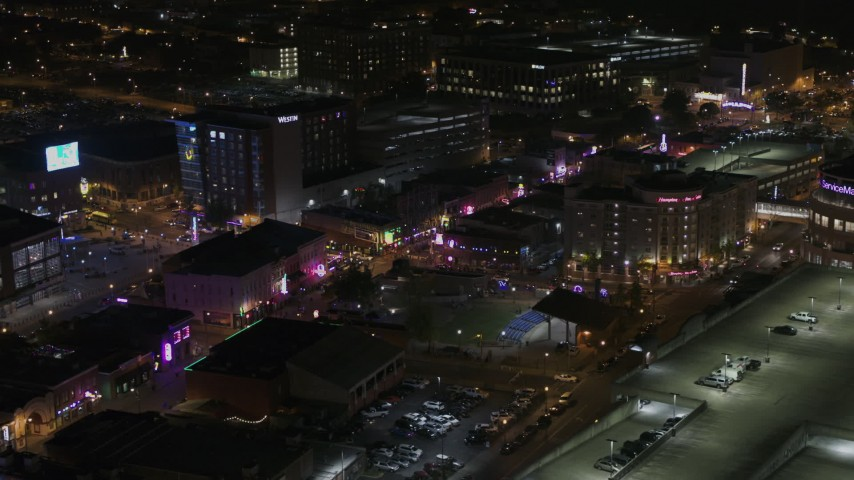 5.7K stock footage aerial video of circling a Beale Street intersection at nighttime, Downtown Memphis, Tennessee Aerial Stock Footage | DX0002_188_010