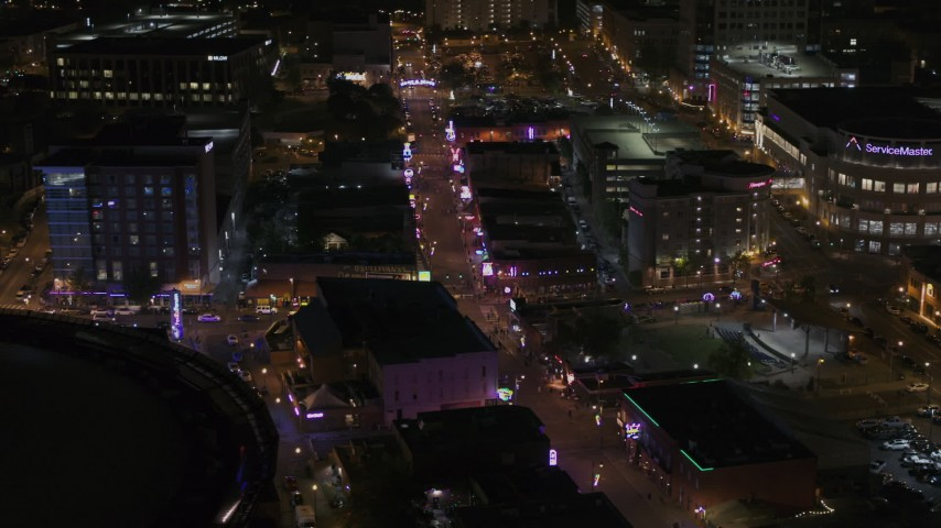 5.7K stock footage aerial video of colorful lights and signs on Beale Street at nighttime, Downtown Memphis, Tennessee Aerial Stock Footage | DX0002_188_011