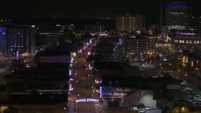 5.7K stock footage aerial video fly around arena to reveal Beale Street at nighttime, Downtown Memphis, Tennessee Aerial Stock Footage | DX0002_188_013