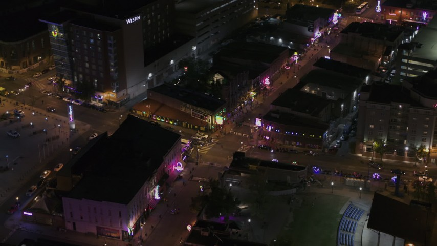 5.7K stock footage aerial video orbit and fly away from a busy Beale Street intersection at nighttime, Downtown Memphis, Tennessee Aerial Stock Footage | DX0002_188_015