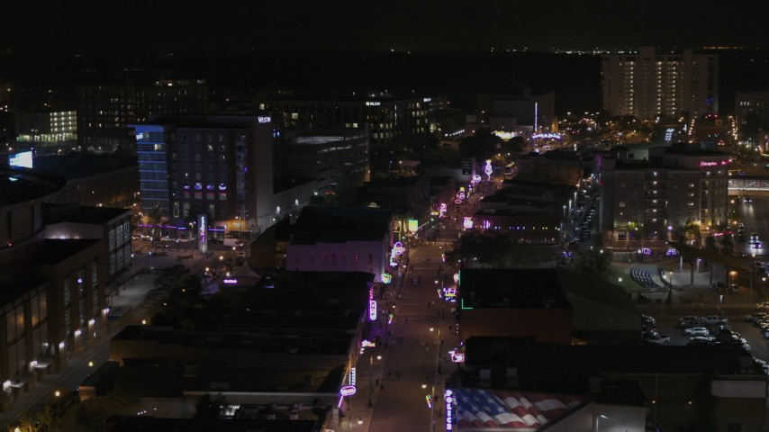 5.7K stock footage aerial video of orbiting busy Beale Street at nighttime, Downtown Memphis, Tennessee Aerial Stock Footage | DX0002_188_017