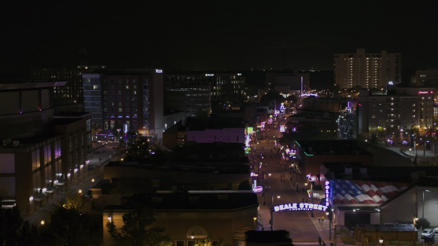 5.7K stock footage aerial video of flying past busy Beale Street at nighttime, Downtown Memphis, Tennessee Aerial Stock Footage | DX0002_188_018