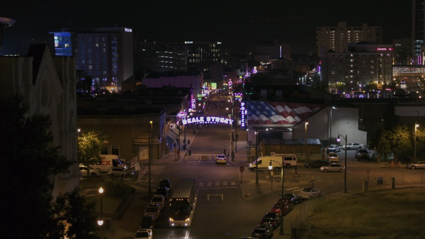 5.7K stock footage aerial video of flying by trees and building to reveal the Beale Street sign at nighttime, Downtown Memphis, Tennessee Aerial Stock Footage | DX0002_188_021