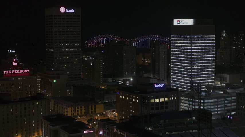 5.7K stock footage aerial video of city buildings between office towers at nighttime, Downtown Memphis, Tennessee Aerial Stock Footage | DX0002_188_022
