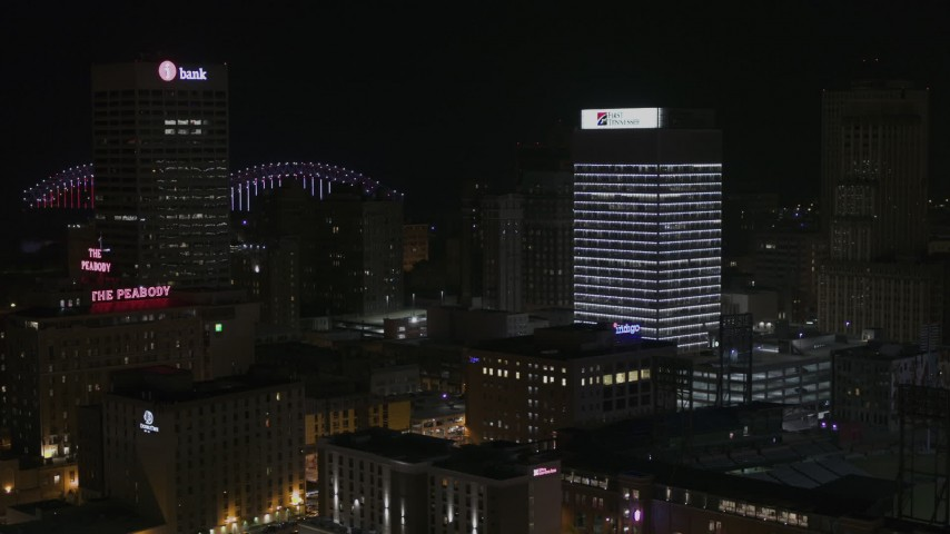5.7K stock footage aerial video of flying away from an office tower at nighttime, Downtown Memphis, Tennessee Aerial Stock Footage | DX0002_188_023