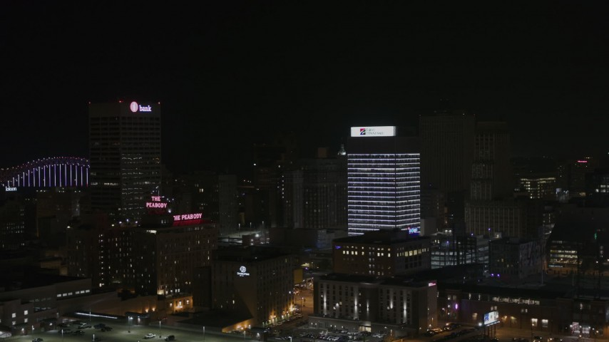 5.7K stock footage aerial video of a reverse view of an office tower at nighttime, Downtown Memphis, Tennessee Aerial Stock Footage | DX0002_188_024