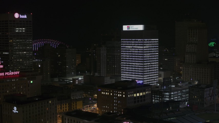 5.7K stock footage aerial video of slowly approaching First Tennessee Building at nighttime, Downtown Memphis, Tennessee Aerial Stock Footage | DX0002_188_025