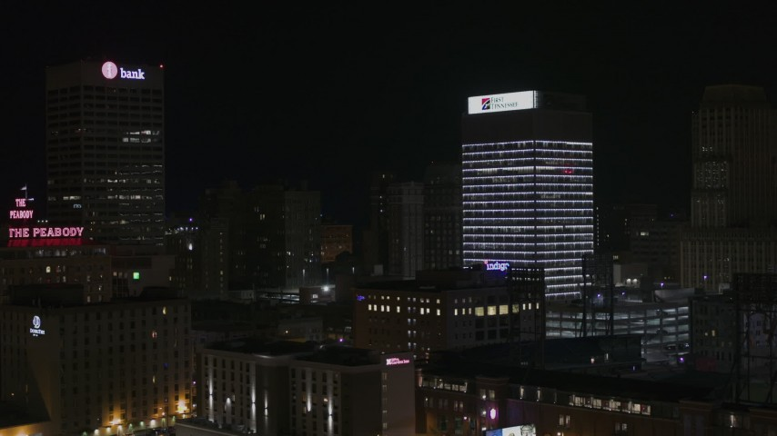 5.7K stock footage aerial video of fly away from First Tennessee Building at nighttime and descend, Downtown Memphis, Tennessee Aerial Stock Footage | DX0002_188_026
